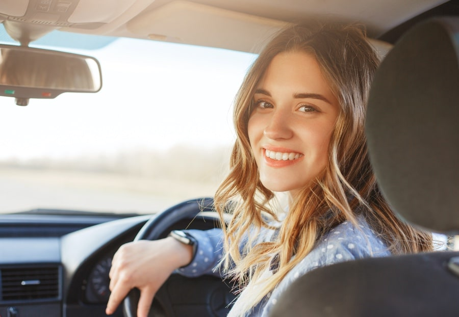Driving lessons young woman learning to drive